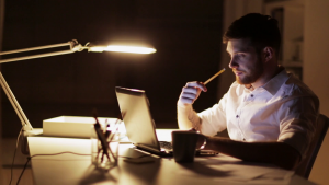 business-overwork-deadline-and-people-concept-man-with-laptop-and-papers-working-at-night-office_siawohrue_thumbnail-full01